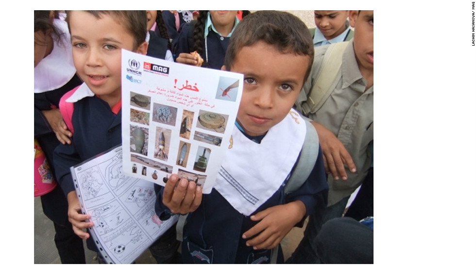 Children show Risk Education posters distributed by Mines Advisory Group in the Nafusa Mountains, Libya.
