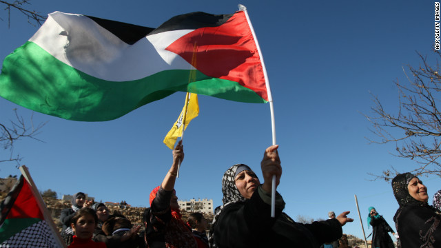 Palestinian women await the release of prisoners outside an Israeli prison in the West Bank on Saturday.