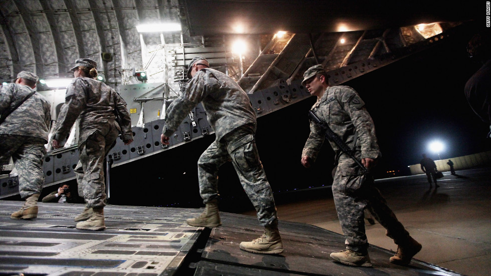 Soldiers from the 3rd Brigade, 1st Cavalry Division board a C-17 transport plane to depart from Iraq at Camp Adder, now known as Imam Ali Base, on December 17 near Nasiriyah, Iraq.