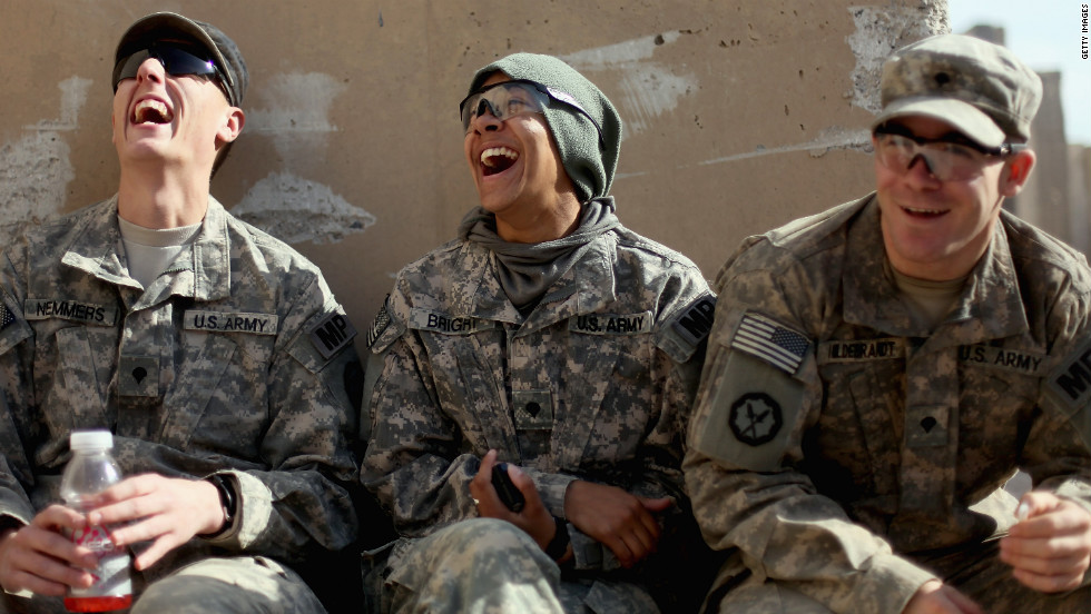 Soldiers (left to right) Peter Nemmers, Morgan Bright and Matthew Hildebrandt from the 3rd Brigade, 1st Cavalry Division laugh while preparing to depart from Iraq at Camp Adder.