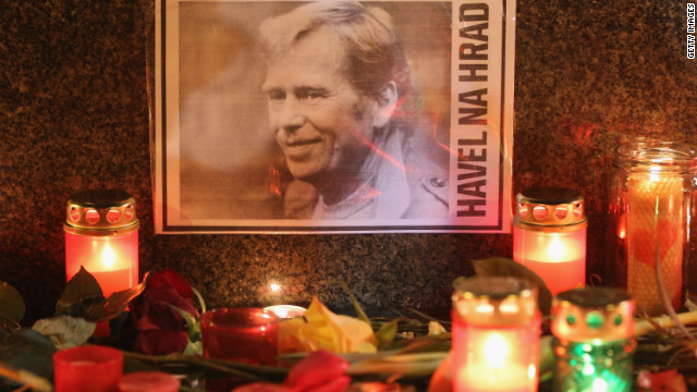A portrait of former Czech President Vaclav Havel, with a text that reads: 'Havel To The Castle,' a popular slogan during the Velvet Revolution of 1989, lies among candles left by mourners at the base of a statue of St. Wenceslas to commemorate Havel's death on December 18, 2011 in Prague, Czech Republic.