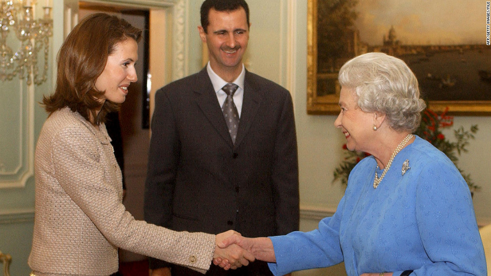 Asma Al-Assad meets Queen Elizabeth at Buckingham Palace in London in December 2002.