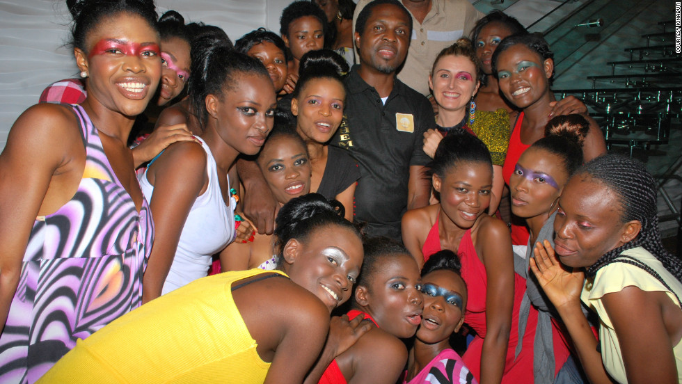 In July 2011, the models participated in the Nehemiah project, focused on rebuilding the local community and infrastructure. Here they pose with Bortolussi and Nehemiah Project founder Tonye Cole.