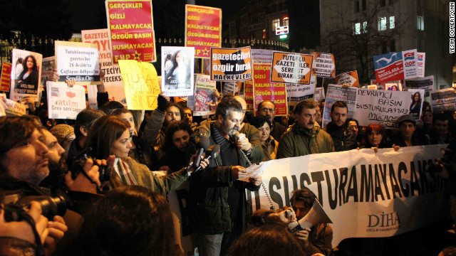 Journalists and human rights activists gather in Istanbul on Tuesday to protest the detention of dozens of journalists.