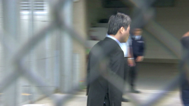 'Accidental millionaire' awaits trial