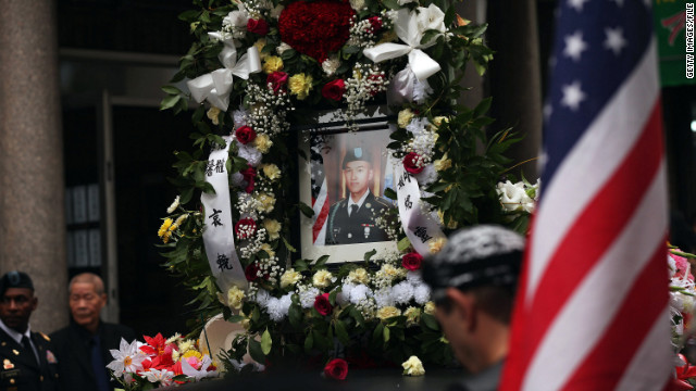 A portrait of Pvt. Danny Chen is carried during his 2011 funeral procession in New York.