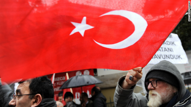 A man waves a Turkish flag as he takes part in a rally in front of the French Consulate in Istanbul on December 22.