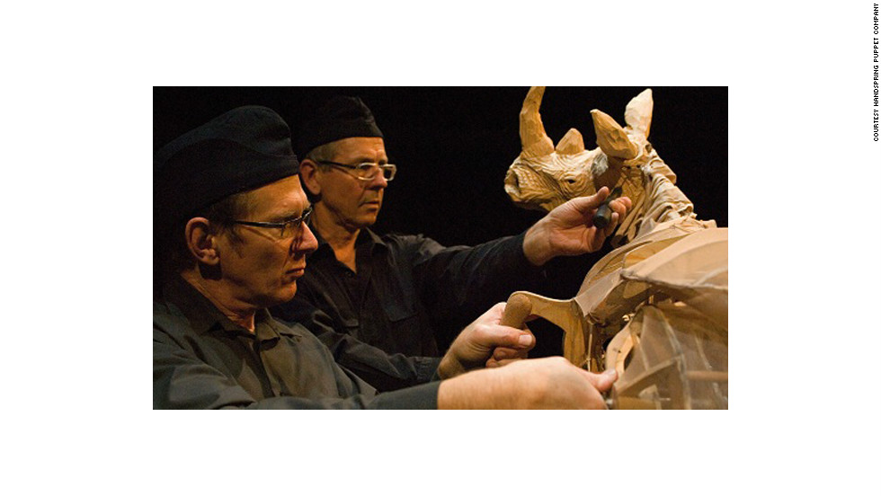 "Adrian Kohler (foreground) and Basil Jones (back) manipulate a rhino for the Handspring Puppet Company's ""Woyzeck on the Highveld"" show."