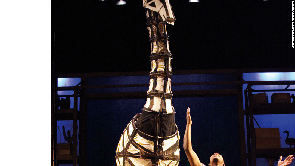 "Actor Sandile Matsheni performs with a giraffe puppet in ""Tall Horse,"" a Handspring Puppets Company production at The Baxter Theatre, Cape Town, in 2004."