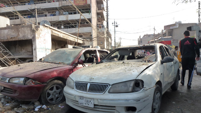 Car windows were shattered during a wave of Baghdad bombings that killed nearly 70 people last month.