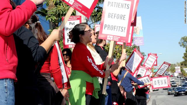 Striking nurses rally Thursday near a hospital in Long Beach, California.