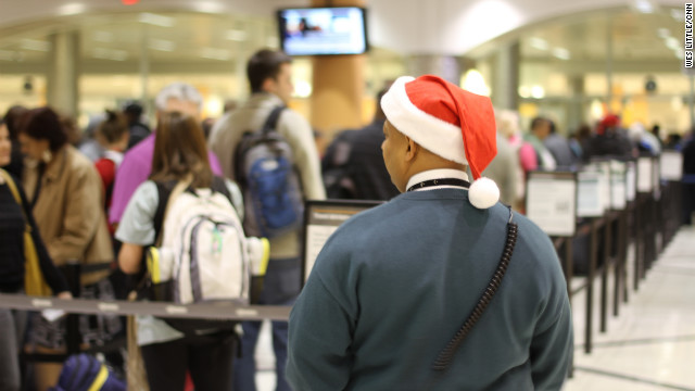 Travelers move through security lines Friday at Atlanta's Hartsfield-Jackson International Airport.