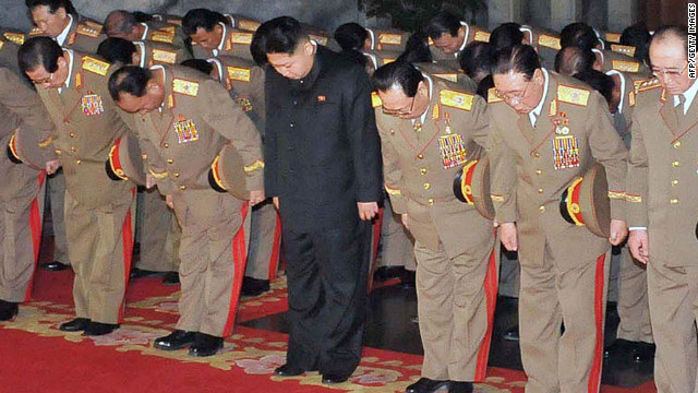 Senior North Korean officials and new leader Kim Jong Un pay their respects to Kim Jong Il.