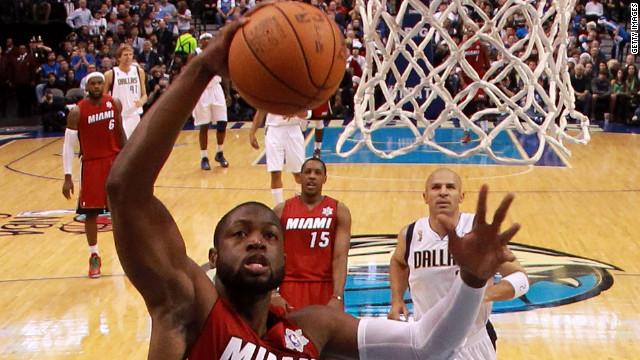 Miami Heat's Dwyane Wade  takes a shot against the Dallas Mavericks during the NBA season opening game.