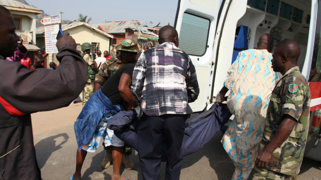 Medics carry the body of a victim after a bomb blast at St. Theresa Catholic Church inNigeria's capital, Abuja, on December 25.
