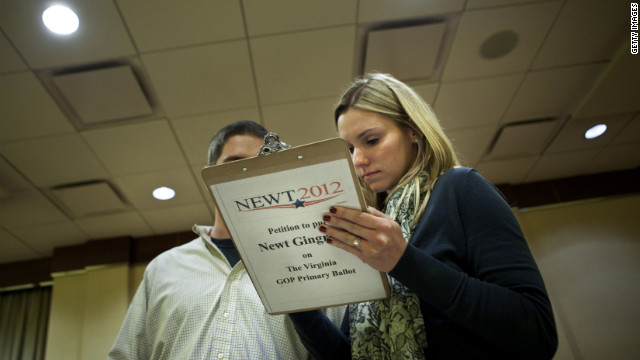 Carlee Daughety signs a petition December 21 in Arlington, Virginia, for Newt Gingrich's name to be on the GOP primary ballot.