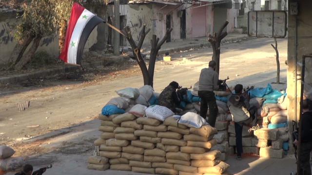 Syrian army defectors defend Homs