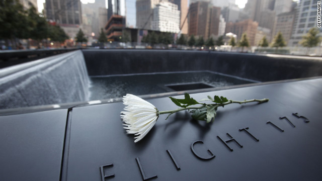 A flower sits on one of the panels containing names of the victims of the terrorist attacks from September 11, 2001, at the 9/11 Memorial.