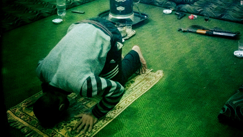 "A defected officer, ""Razik,"" prays at a safe house in Homs."