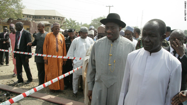 Nigerian President Goodluck Jonathan, wearing black hat, visits the damaged St. Theresa Catholic Church in Madalla on Saturday.