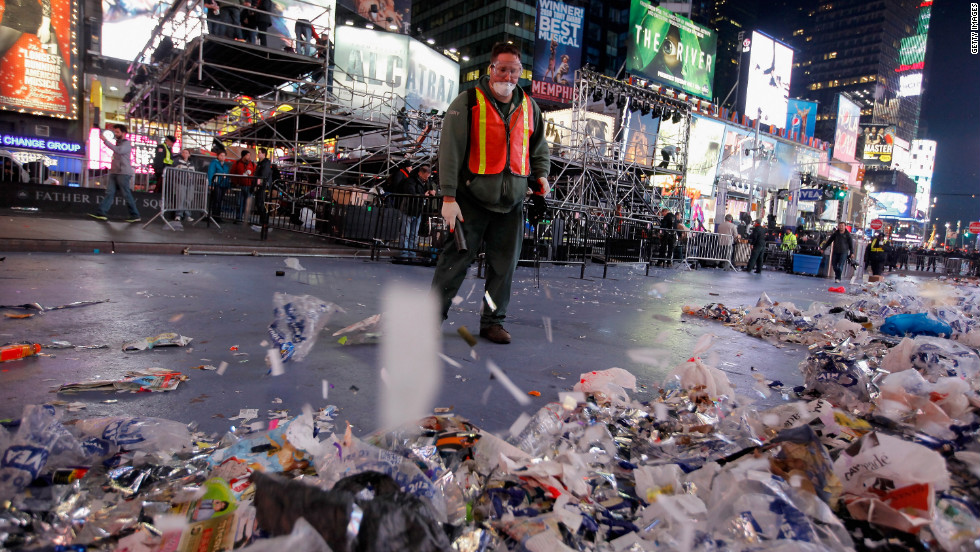 Workers clean up after thousands of revelers gathered in New York's Times Square to celebrate the ball drop at the annual New Year's Eve celebration.