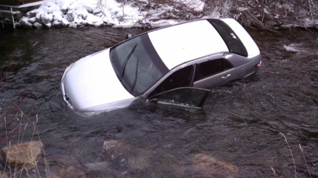 Three kids rescued from car in icy river