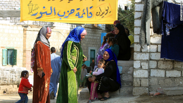 Egyptian women gather near a polling station in Minya, during the final round of  parliamentary elections on January 3, 2012.
