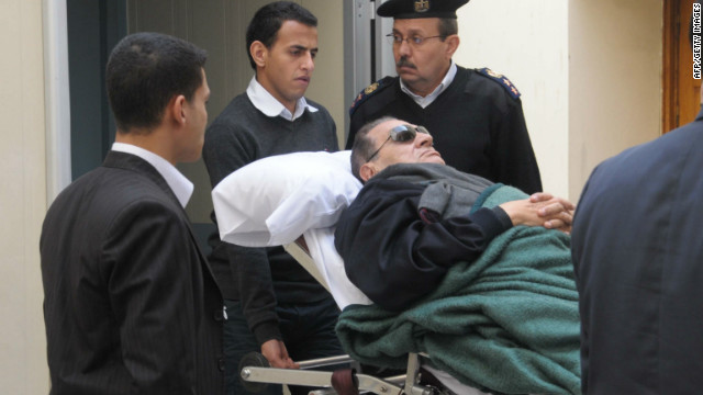 Former president Hosni Mubarak lies on a stretcher as he leaves court in Cairo on January 2.