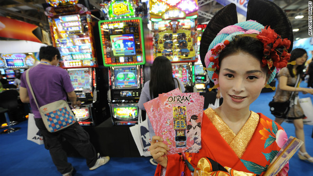 A model poses for pictures at a gaming exhibition in Macau on June 8, 2011.