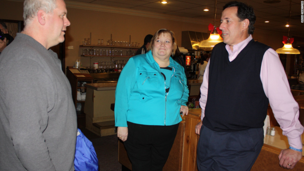 Santorum again employs a dark blue sweater vest (we never tire of typing that) to woo potential voters in Denison, Iowa. Maybe we should credit the pink dress shirt (again) for the CNN entrance polls that showed him the most popular candidate among Iowa female voters.