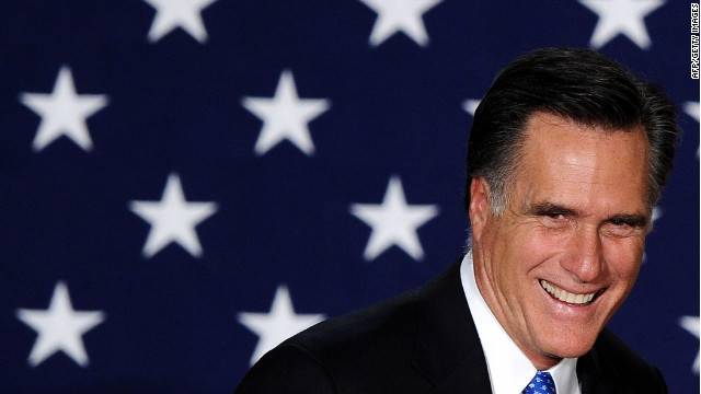 Mitt Romney appears at a rally Tuesday night in Des Moines, Iowa.