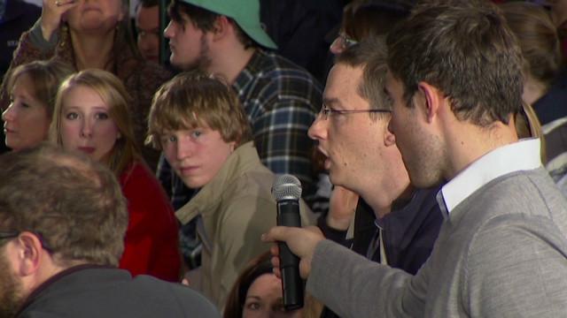 Romney endures harsh questions