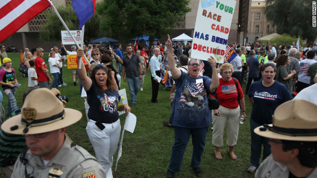 Supporters of Arizona's tough new  immigration law rally in  Phoenix when the law was proposed in 2010.