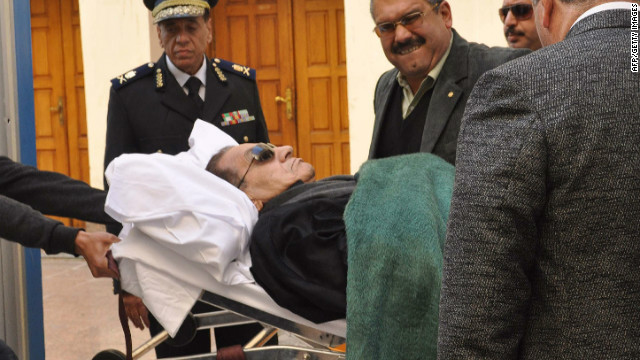 Ousted Egyptian president Hosni Mubarak is wheeled on a stetcher into the courtroom in Cairo on January 3, 2012, for the continuation of his trial.