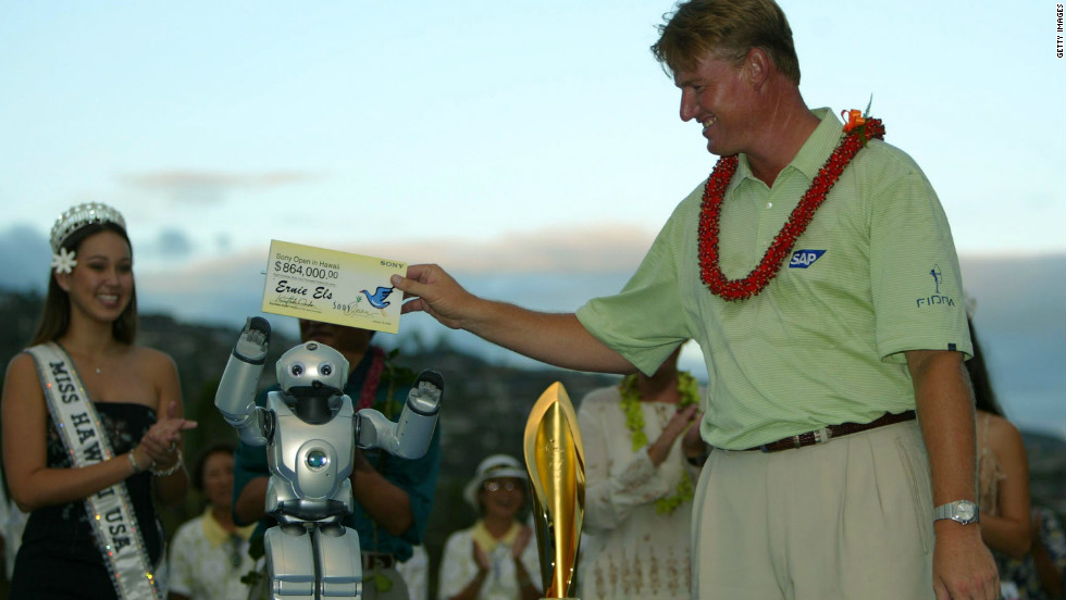 South African star Ernie Els receives his winning check from Qrio at the 2004 Sony Open.