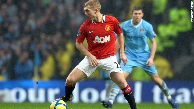 Paul Scholes controls the ball as he comes out of retirement for Man Utd in their FA Cup tie against Man City.
