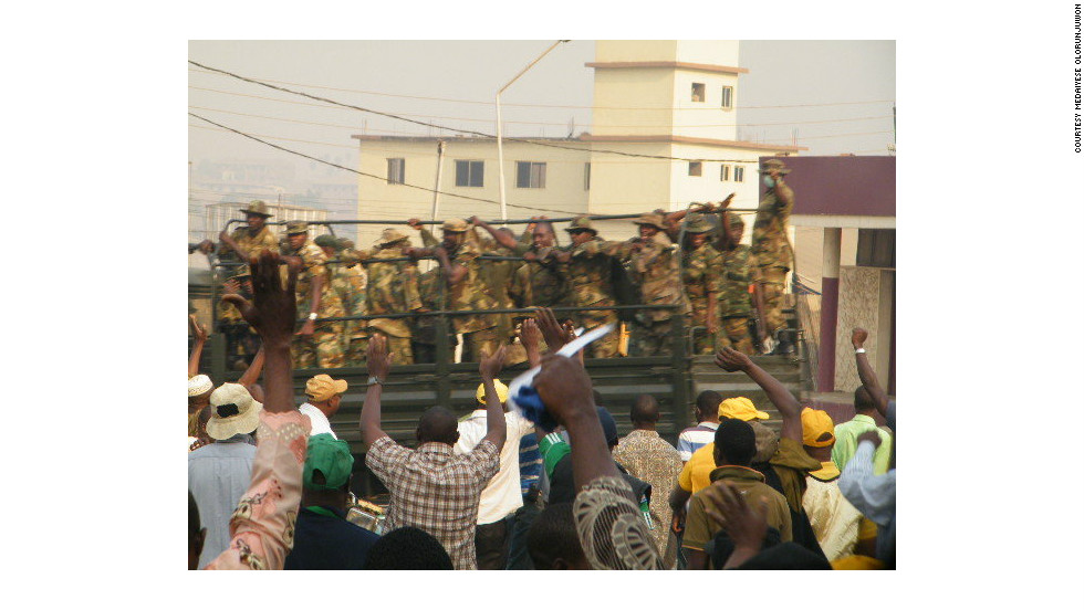 "This picture, taken by iReporter Medaiyese Olorunjuwon shows the armed forces monitoring protesters in the city of Ilorin, Kwara State capital. Olorunjuwon said: ""The protesters were cheering the armed forces... All in all it was peaceful."""