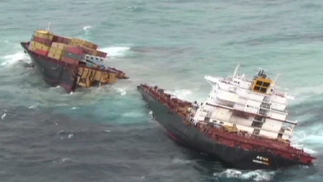 Debris spews from split cargo ship