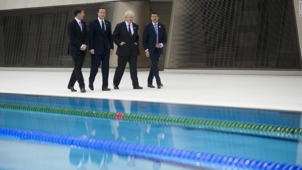 Cameron (center left) is joined by Olympic secretary Jeremy Hunt (far left), London mayor Boris Johnson (center right) and chairman of the London 2012 organizing committee Sebastian Coe in a stroll round the Aquatics Centre.
