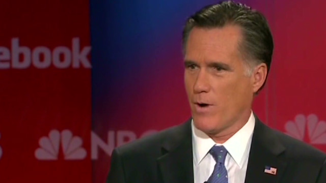 Romney under fire in debate