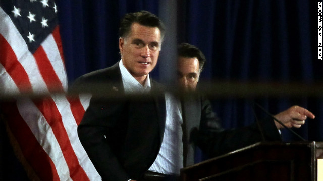 Mitt Romney is seen reflected in a mirror as he speaks in Nashua, New Hampshire.