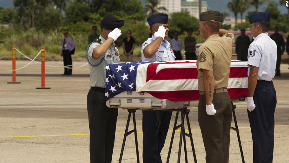 A U.S. military detail from JPAC honors the sacrifice made by Americans during a repatriation ceremony at Da Nang International Airport, Vietnam, before the body is flown home.