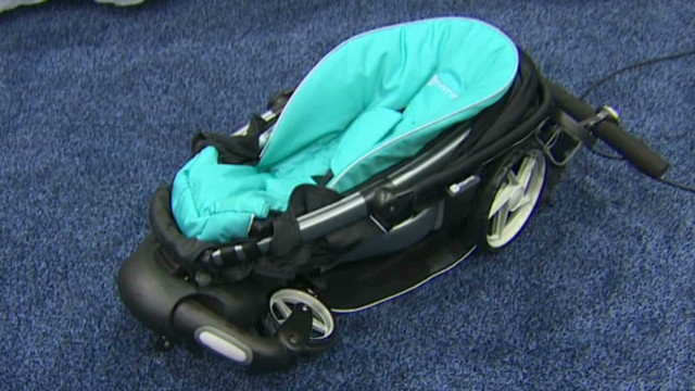Stroller sets up with touch of a button