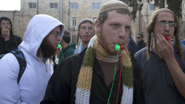 Jewish rightwing protestors demonstrate in support of a comrade arrested over 'price tag' crimes in Jerusalem on January 3, 2012.