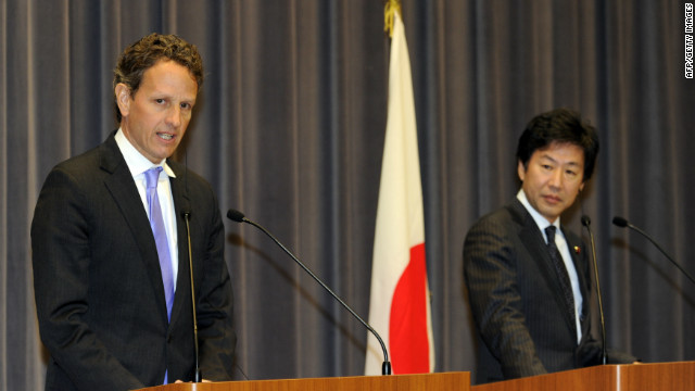 US Treasury Secretary Timothy Geithner, left, at a press conference with his Japanese counterpart Jun Azumilooks at Japan's finance ministry in Tokyo on January 12, 2012.