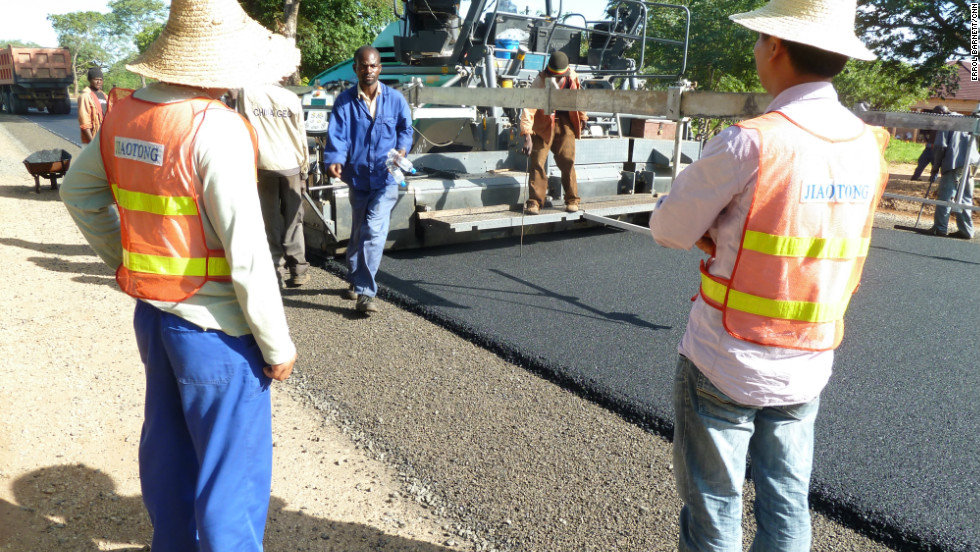 Chinese and Zambian workers building a new road in Zambia.