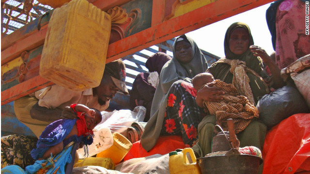 Somalis displaced by famine sit in the back of a truck ready to leave an internally displaced persons camp in Mogadishu Sunday.
