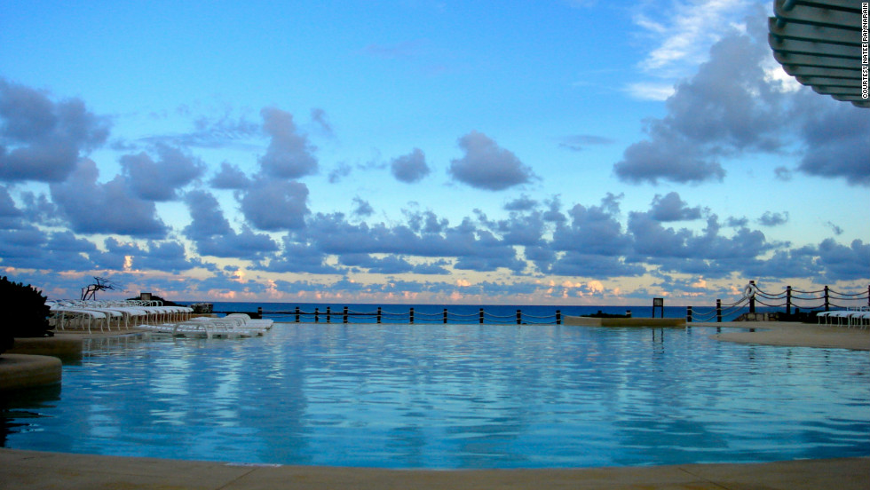 "Natee Ramnarain took this serene photo while on her honeymoon in Cancun. ""It was at the Hyatt Cancun Caribe at one of the the two swimming pools they had on site. I was sitting in a cabana and thought the sky looked perfect."""
