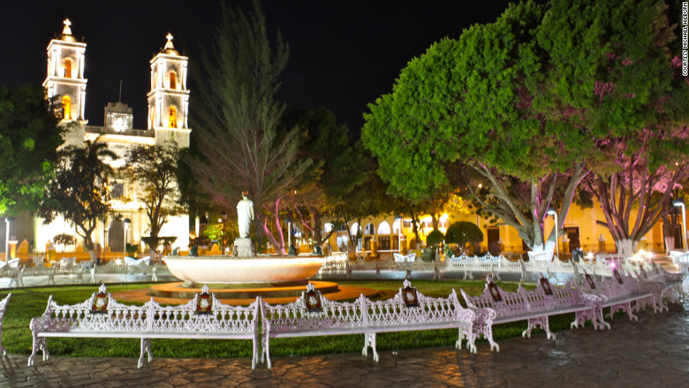"Michael Hilburn took this photo of Valladolid plaza at night. ""This city, like most Spanish colonial towns, had a huge central plaza, which was beautifully lit at night and full of majestic old trees and fountains."""