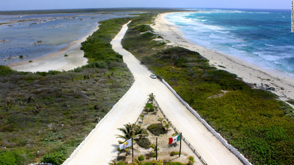 "Michael Hilburn captured this view ""with the Caribbean on the right and a crocodile infested lagoon to the left"" from the top of the lighthouse at Punta Sur Ecological Reserve."